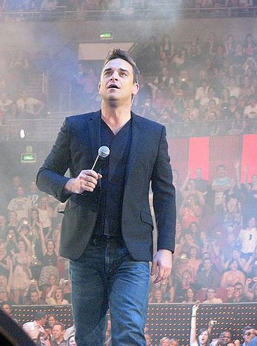 Robbie Williams suggests a reunion with Take That
