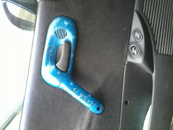 Poignée de porte côté chauffeur
