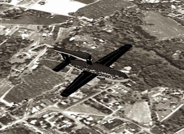 Bombe V1 en vole et des soldats alliées examinant des nez de fuselage avant de bombe V1 dans une galerie d'une usine souterraine