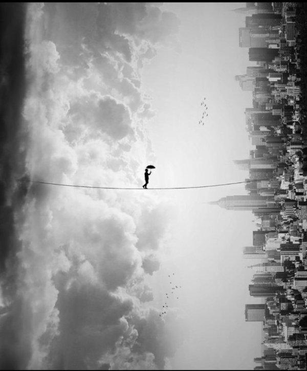 Suspendu sur un fil comme un funambule je contemple ce monde de brut