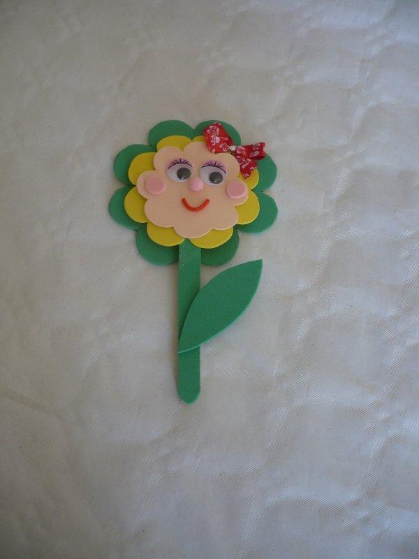 Une jolie fleur sourire pour maman .