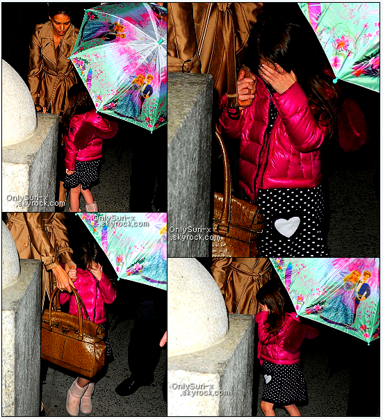 .  Suri Cruise and Katie holmes in NYC- March 8th 2011    Katie Holmes and her 4-year-old daughter Suri get shielded by umbrellas while heading back to their apartment on Tuesday ,March 8th in New York City.Earlier in the evening, the mother-daughter duo went to see How to Succeed in Business Without Really Trying on Broadway.The 32-year-old actress and Suri received a police escort out of the theater after the show, which stars Daniel Radcliffe. Katie and Suri flew in from Vancouver, Canada, where they had been visiting Tom Cruise on the set of his new movie, Mission: Impossible - Ghost Protocol.   .