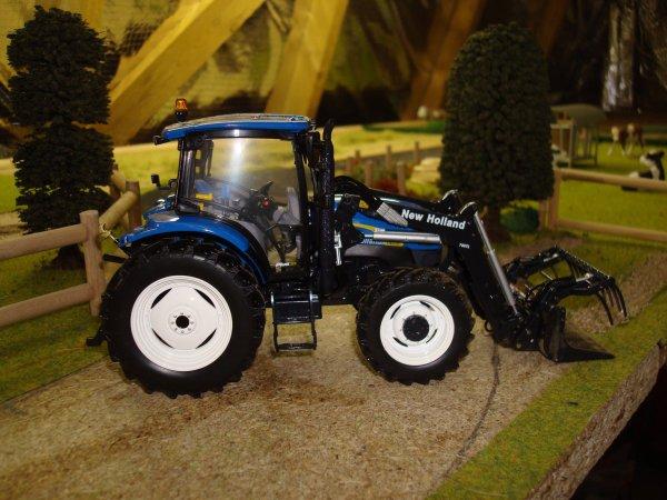 vends tracteur nh avec chargeur 35 euros+fdp