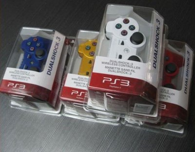 Manette noir - blanc - rouge - bleu - or  PS3 35 eur