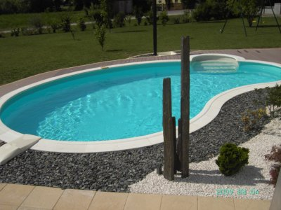 Am nagement d co piscine construction piscine for Deco bord de piscine