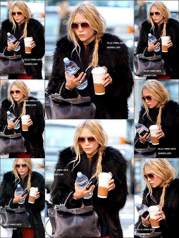*   Mary-Kate sortant dehors tout en se promenant dans Soho a New York City le 03/02/11   *