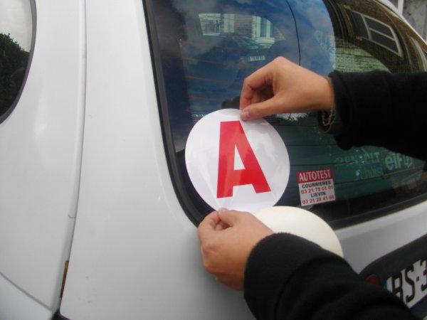 la pose du 2eme A  sur mon autre voiture hihihi