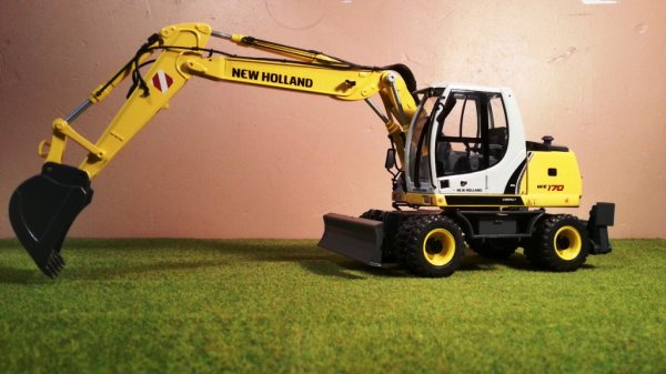 News: Pelleteuse NewHolland WE170; Pro Farm Toys