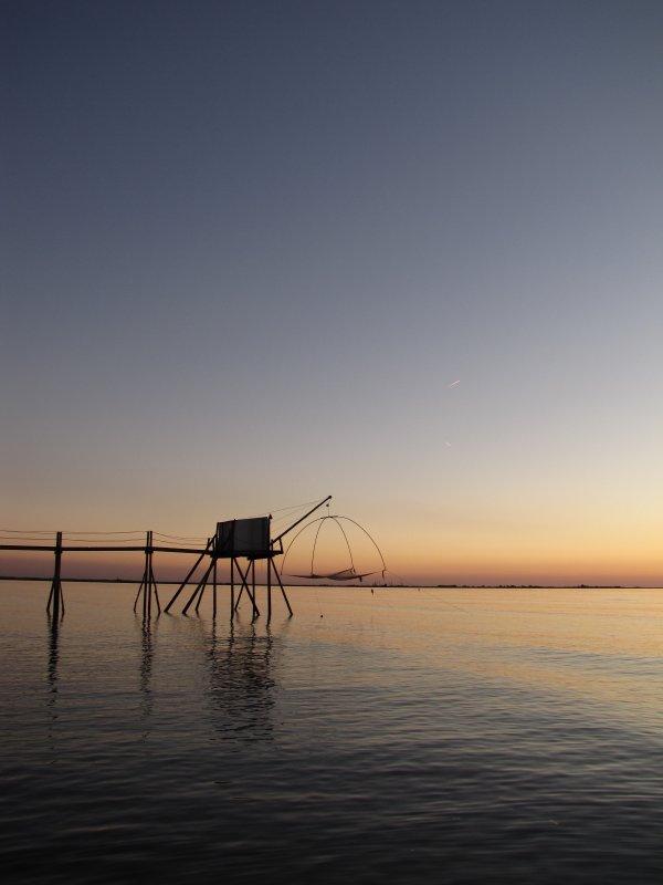 soleil couchant sur pêcherie