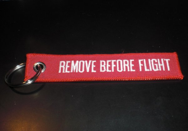 porte clé tissu REMOVE BEFORE FLIGHT