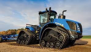 NEW HOLLAND T9 . LE T9 A CHENILLE . IL EST DEMON NN?