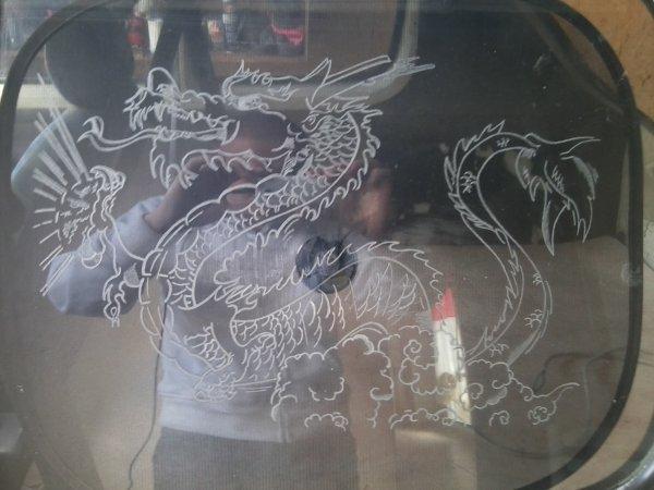 le dragon ke j ai fai sur la voiture de mon pere