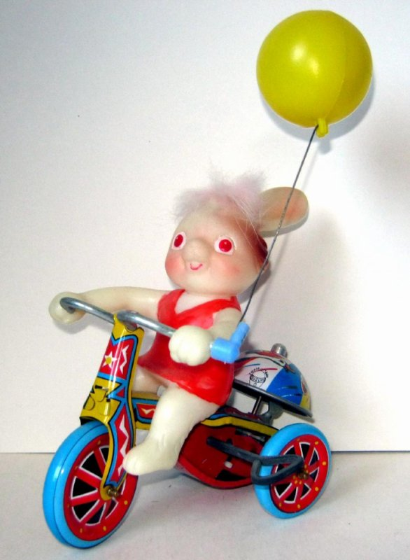 "AUTOMATE MECANIQUE MADE IN JAPAN - R (entre 2 poissons) ? "" BUNNY HAPPY EASTER TRICYCLE "" "" LAPIN QUI FAIT DU TRICYCLE """