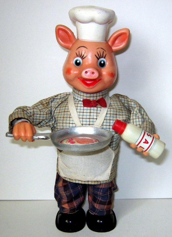 "AUTOMATE MECANIQUE MADE IN JAPAN - YONEZAWA "" PIGGY COOK MECANIQUE "" 24,5cm Hauteur "" COCHON QUI FAIT CUIRE SON STEACK "" VOIR VIDEO JOINTE"