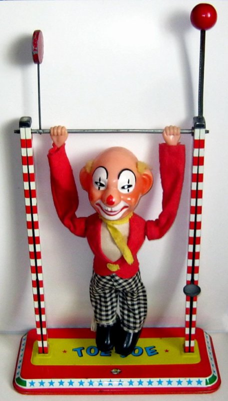 "ARNOLD CLOWN ACROBATE MECANISME MANUEL "" TOE-JOE "" HAUTEUR 42cm"