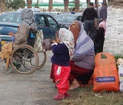 Des réfugiés syriens en quête de dons