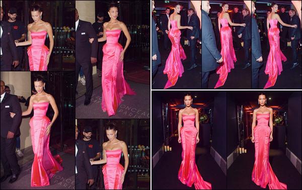 - '-• 27/09/18-''─ Bella Hadid se rendait à la soirée de « Naked Heart Fragrance Gala Dinner » ayant lieu à Paris. Affublée d'une robe rose Barbie et lui serrant le corps étroitement, la mannequin quittait « Le Royal Monceau » en direction de la soirée ! -