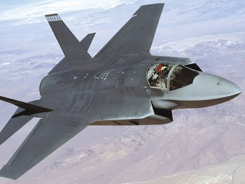 Au début des années 1990, l'US Navy lance un programme A/F-X pour remplacer ses A-6 Intruder, l'US Air Force commence à réfléchir à un successeur du F-16, tandis que l'US Marine Corps recherche un avion de type aéronef à décollage et atterrissage verticaux (ADAV) plus performant que ses AV-8 Harrier II. Sous la pression du Pentagone, et afin de réduire les coûts de développement, ces trois besoins sont regroupés dans un programme unique baptisé « Joint Advanced Strike Technology » (JAST).