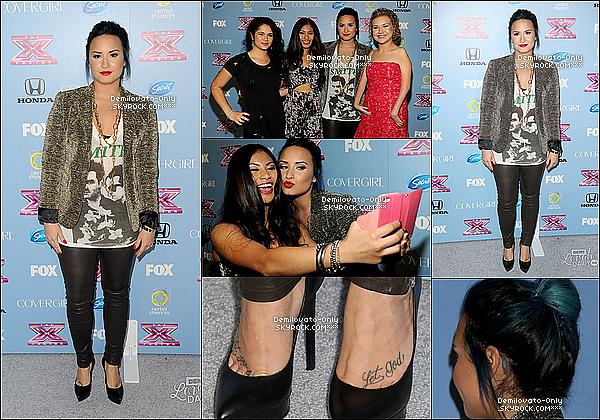 .   04.11.13 : Demi, vêtue d'un joli TOP, assistant à la X Factor Party, à Los Angeles.   .