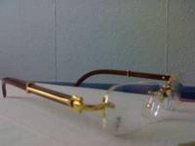 Lunette Cartier avec cadre de couleur Or et en bois facon laqué ... daa338f55618