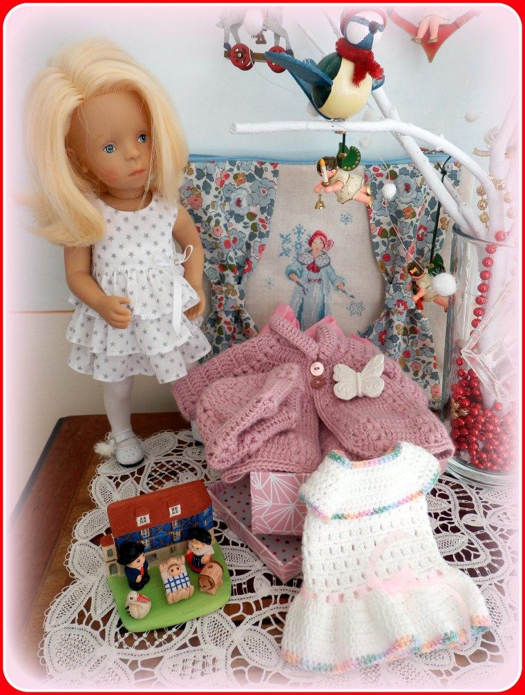 Minouche a, elle aussi, reçu une jolie boîte dans les tons roses....