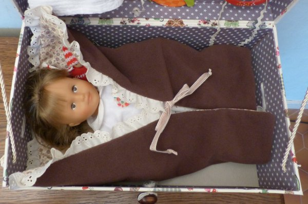 Trousseau de bébé : passe-couloir et tenue de sortie