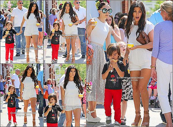 * 14/06/14 : Grosse journée pour la petite famille, elle était avec Mason dans Southhamptons, glace à la main.*