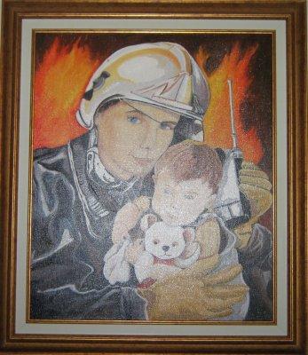 Le sapeur  et l'enfant réalisée pour mon mari ,c est un ancien sapeur pompier