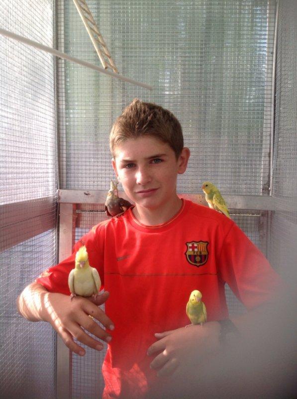 Moi avec mes perruches