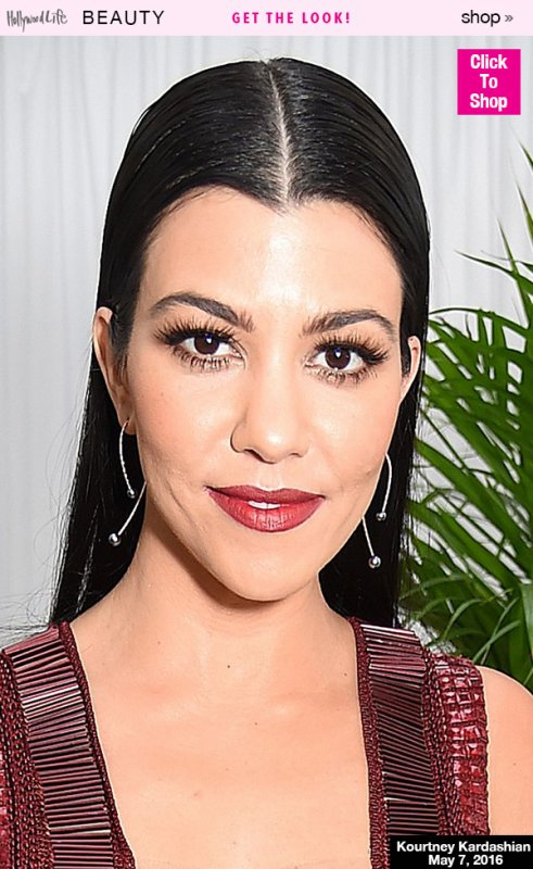 Kourtney Kardashian displays off her small frame in chic crop-top for skincare brand's photocall