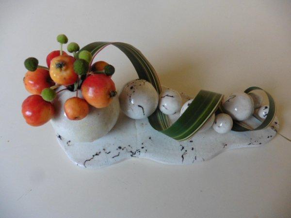 Petite pommes  sur un raku  crin de cheval