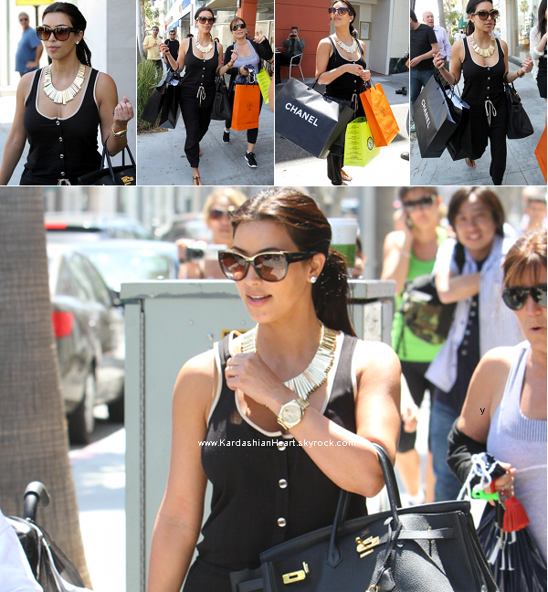 . 5.4.11 Kim en train de faire du shopping à Beverly Hills .