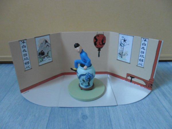 Scène Tintin sortant de la potiche