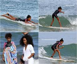willow en train de faire du surf en vacances