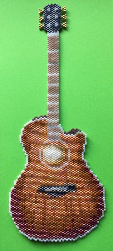 Perles : la guitare folk