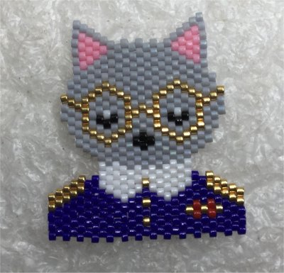 Perles : broche chat à galons