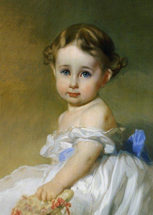 cette petite fille  aux grands yeux étonnés a tout le charme de l'enfance .
