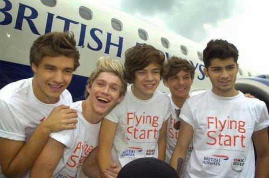 Cmbien De J'aime pour cette photo Des One Direction a L'areoport de L'Angleterre le 21 juin 2012