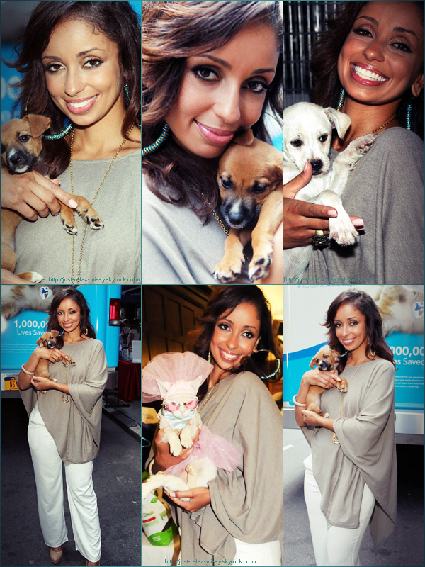Candid. Mya Shows Puppy Love at Animal Rescue Event