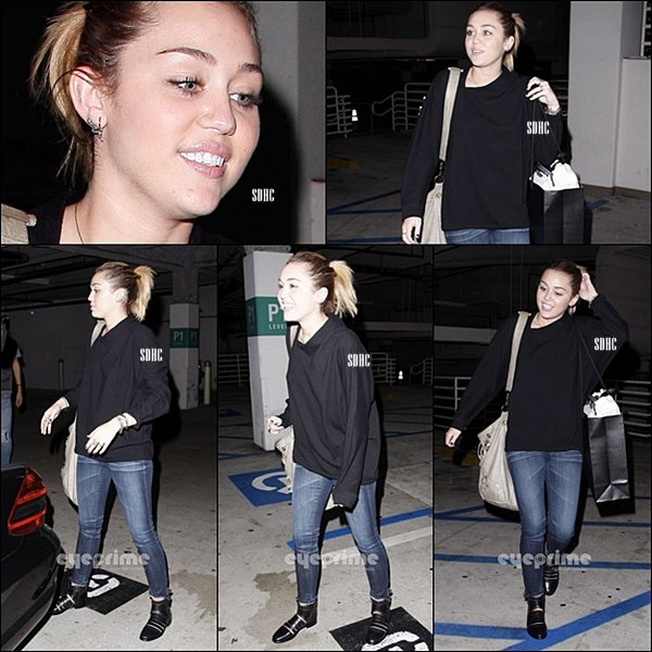 . 01/11- Miley faisant un peu de shopping avec son ami photographe Vijat chez Barneys New York, à Beverly Hills (Californie) .