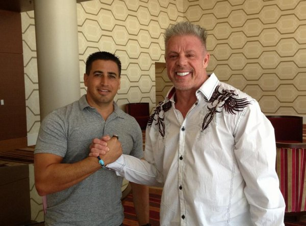 Justin Roberts with The Ultimate Warrior