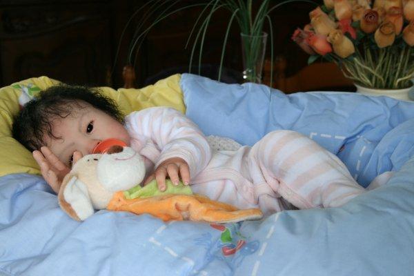Mei-li mesure 56 cm elle s'habille donc en 1 mois