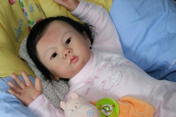 Li-an mesure 56 cm tout comme Mei-li