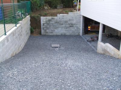 La descente de garage et le vrai puisard photos de la maison for Revetement descente de garage