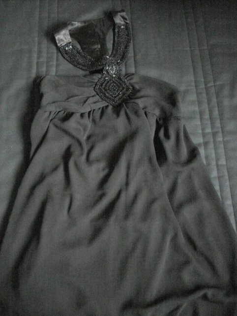 Robe noir.