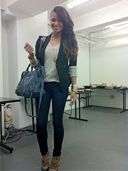 On the set for Teen Vogue Cassie arrives on set with a blue Balenciaga bag and some serious bling.