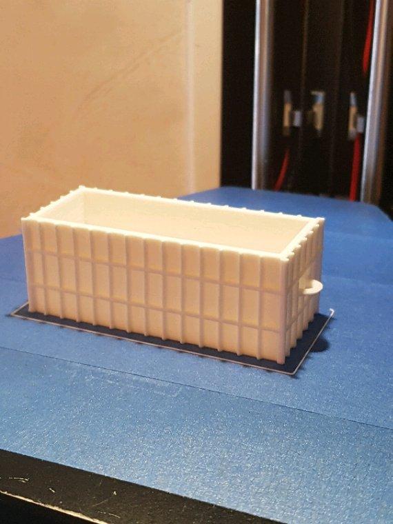 Fraîchement sortie se l'imprimante: une benne à ordure pour la déchetterie du réseau