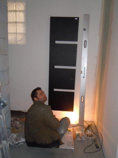 Montage des sèche-serviettes et des radiateurs.