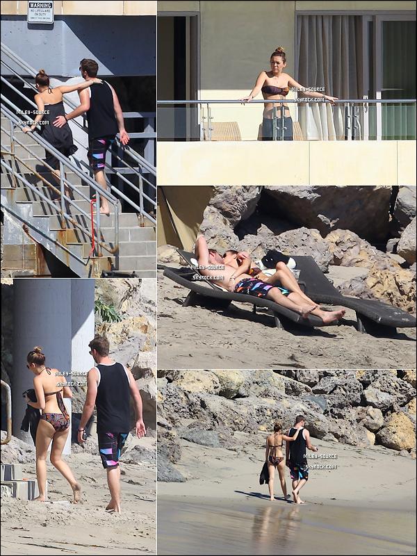 13.10.11 | Miley  et son petit ami Liam Hemsworth prennent du bon temps sur la magnifique plage de Malibu.