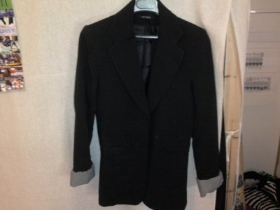 Veste noire, taille, prix 20 euros